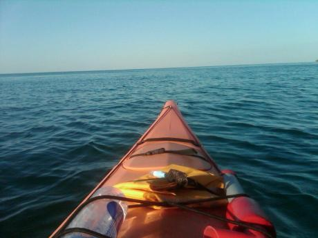 looking out over the tip of a kayak on Lake Superior